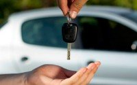 An image of a man handing over his car keys