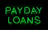 An image of a neon payday loans sign