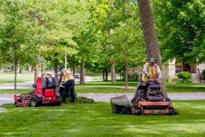 An image of an industrial lawn mower being used