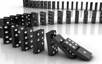 An image of dominos falling