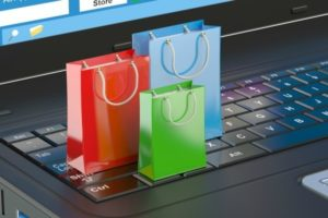 An image of shopping bags on a laptop