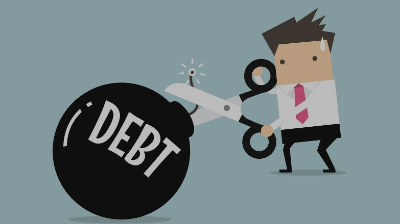 An image of a man dealing with debt