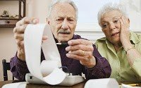 An Image of 2 Pensioners Working Through Their Bills