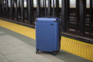 An image of a hard-sided suitcase