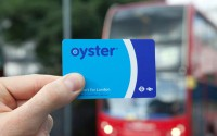 An Image of a Man Holding A Blue Oyster Card