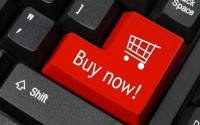 An Image of a Red Buy Now Button On a Computer Keyboard