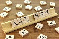 An image showing scrabble tiles saying act now