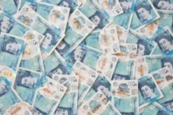 An image of lots of five pound notes