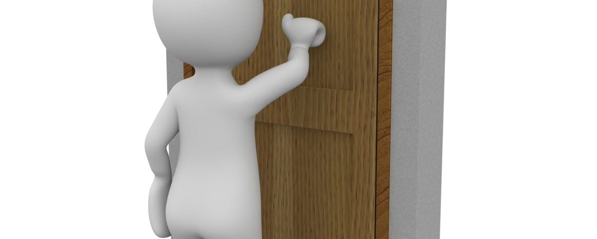 An image of a person knocking on a front door