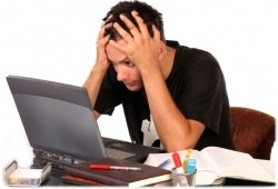 stressed man by computer