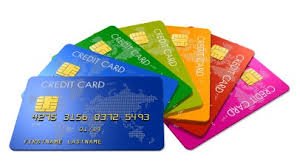 An image of 7 different coloured credit cards