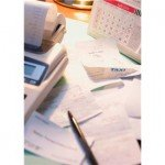 A Picture of a Stack of Receipts and a Calculator