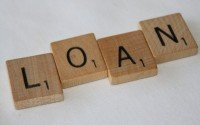 An image showing scrabble tiles spelling loan
