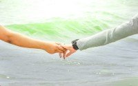An image of two people holding hands