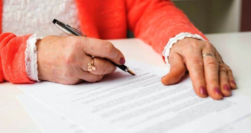 An image of a lady writing a will