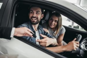 An image of a couple who have just purchased a car
