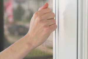 An image of someone knocking on a door