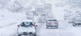 An image of cars driving in the snow