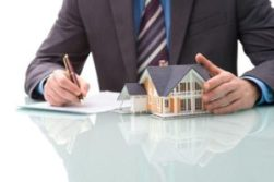 An image of a man signing a contract news to a model house