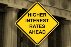 An image of a warning of higher interest rates