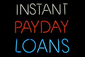 an image of a neon instant payday loans sign